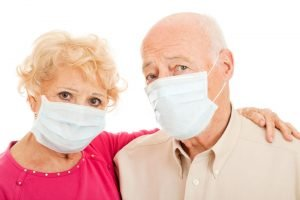 Retirement In Lockdown - Couple In Masks